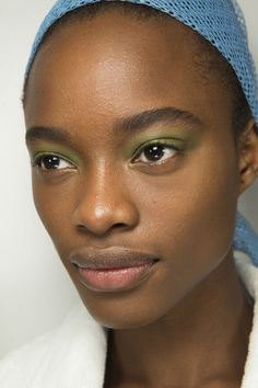 At Marni, Pat McGrath applied pastel shadow in pink, lilac and chartreuse in a wash across models' eyelids.