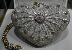 "House of Mouawad from Dubai, presented a purse called the ""1001 Nights Diamond Purse», which was recorded in the Guinness Book of Records as the most expensive purse in the world. Its cost is 3.8 million dollars."