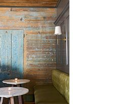 @AngieHranowsky, weathered paneled walls, tufted bench, carrera tables.  GORGEOUS