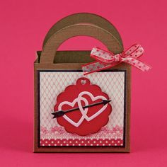 Great for a Valentines Day Treat! Create this gift bag by using Top Dog Dies Heart Mini Album Finishers Die Set and Treat Bag Die.