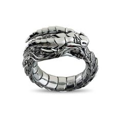 <ul> <li>Men's Silver Dragon Ring.</li> <li>193 black diamonds totaling 2.0 carats encrust the dragon scales.</li> <li>2 blood red rubies for eyes.</li> <li>Design features the Ouroboros Dragon, devouring its own tail.</li> <li>Unique men's ring, designed and handcrafted in the United States.</li> <li>12mm wide.</li> <li>Nick's Notes: The Dragon's ferocit...
