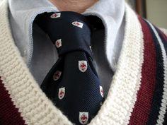 Brooks Brothers blue OCBD, Raphael Vierri emblematic tie, Ralph Lauren Polo cotton/cashmere tennis sweater.
