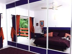 Mirror doors with purple mesh, adding contrast to the beautiful design of this home.  FormFunctionNT
