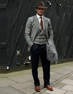 David Gandy, model. (M coat, Neil Fennel October House tailor suit, Thomas Pink shirt, Russell & Bromley shoes, Goorin Brothers hat, Reiss tie.)