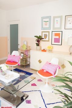 A half-painted wall and some DIY color block art play well together to give a colorful room structure! A home decor trick is to pull in brighter colors from accent pieces in your wall art!