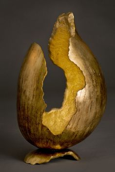 """Keeper of the Fire"" by Serena Kovalosky. (Gourds, gold alloy leaf, bitumen stain)"