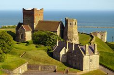Roman Pharos, Saxon Church, and Victorian Garrison School, Dover Castle, Kent, England. Pharos built 46 AD under Emperor Claudius; Aulus Plautius, governor. Ex-belfry to pre-1020 AD St Mary-in-Castro, King Lucius of Britain Church. Restored by Victorians Gilbert Scott, William Butterfield. Garrison School. Bredenstone on Western Heights. Listed Building, English Heritage site, and Scheduled Ancient Monument. Norman Medieval History. Travel, Tourism. See…