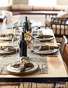 Earthy table linens complement the gorgeous wood underneath. Simple stemware and flatware allows the beautiful vista beyond to be the star of the show. - Photo: John Merkl / Design: Elizabeth Cameron and Kathleen Pfaff