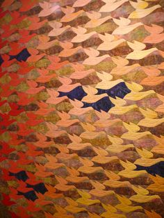 quilt by Mary Knapp which was inspired by Escher drawings. It is called Visual Perception and contains her hand dyed and overdyed fabrics.  Photo by Beth Brandkamp.