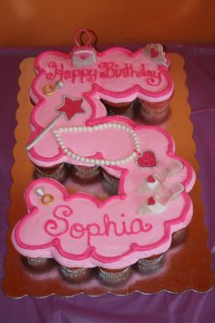 A cupcake cake for a princess' fifth birthday.  Decorations modeled...