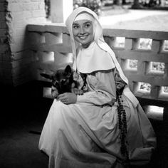 Audrey Hepburn and Novice the dog on the set of A Nun Story