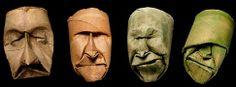 sculpture de Junior Fritz Jacquet. Masques en papier traité créés à partir de pliages et de froissage. Sculptés à la main à partir de rouleau de carton industriels.