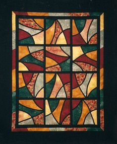 """""""Stained Glass Glow"""" I loved making this wall-hanging. Learning a new skill(which I've now forgotten!), balancing colours and twisting the blocks around to make different designs."""