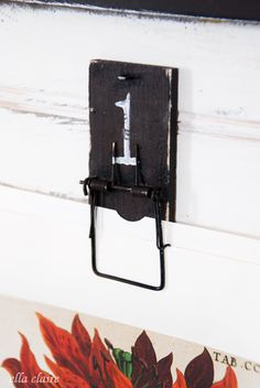 Upcreated Moustraps into clips with a Vintage feel, to hold Gallery Wall Art!  So creative!  Tutorial given