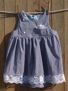 Darling little cotton dress up-cycled from a man's dress shirt. Wear as a sleeveless summer dress or add a t-shirt for added warmth on those cooler days. Features the following: - Size 2 - Original de
