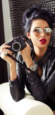 red lips, aviators and a leather jacket.