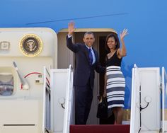 Michelle Obama Africa   President Barack Obama and first lady Michelle Obama wave prior to ...