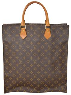 Louis Vuitton Monogram Sac Plat Gm Large Size M51140 Brown Tote Bag. Get one of the hottest styles of the season! The Louis Vuitton Monogram Sac Plat Gm Large Size M51140 Brown Tote Bag is a top 10 member favorite on Tradesy. Save on yours before they're sold out!