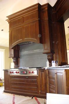 "Walnut oven hood with 36"" wolf range top."