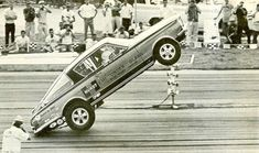 "The Hurst ""Hemi Under Glass"" wheel-stander, driven by Bob Riggle, in action."