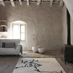 "Rug by Nanimarquina ""Chillida Collection"" Sofa by Joquer ""Simone"" Design by Emiliana Design Studio"