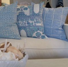 China Seas Nitik II, Sultain II, and Ziggurat pillows by Island Home Palm Beach.