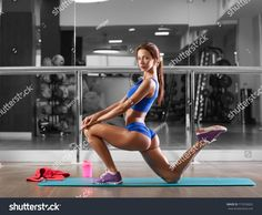 https://image.shutterstock.com/z/stock-photo-attractive-young-woman-is-doing-plank-exercise-while-working-out-in-gym-715536832.jpg