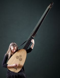 Theorbo -- Lynda Sayce with the theorbo. It has strings lengths of over 170cm and a massive 2 metre neck!
