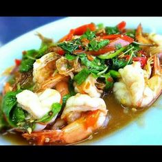 Stir fried prawns with vegetables in fish sauce.