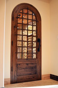 Interesting door...has curve...allows viewing of wine room...iron brings in iron from older part of house