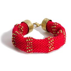 RED wax linen cord mesh bracelet with brass bead detail, with brass clasp closure is available through The Noble Collection. #TheNobleCollection #50Shades