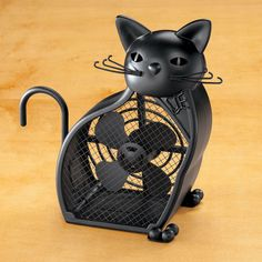 This small battery operated Black Cat Fan would look great on any cat lover's desk.  A unique look for a little personal cooling with the flip of a switch.