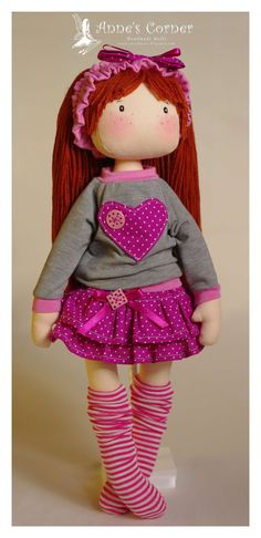 Sweet rag doll for small children with removable clothes (panties, dress, shoes).    All clothes are removable and easy to take off.  Hair are made of