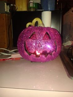 My memorial pumpkin for my mother who passed away from cancer. I used pink paint and pink glitter to make this pumpkin shine!