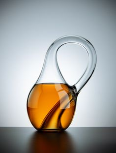 If you want to give a mathematician something to try to wrap their head around, a Klein bottle is a good place to start. It is an object with no inside and no outside that can only exist in 4 dimensions. These glass models exist in 3, which means that unlike the real thing, they can actually hold liquid.The difference between the models and the real thing is that by adding an extra dimension, you can make it so that the neck of the bottle doesn't actually intersect the side of the bottle.