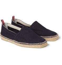 Canvas espadrilles are the perfect slip-on-and-go option for days in the sun. The Castañer family can trace its shoe-making roots back to 1776, and this dark blue version references centuries of design expertise. Wear them with rolled-up chinos for a dash to the shops, switching to shorts at the beach.