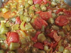 Okra & Stewed Tomatoes-4 slices bacon cut into smallpieces,1/2C onion,1/2C green bellpepper,2 clovesgarlic,1 stalk celery sliced fairlythin,1(29oz) can whole tomatoes,1T chickenbase,  1T sugar,2C fresh okra (no fresh, frozen ok)pepper to taste--Large pan, cook bacon pieces til crisp. Add onion, greenbell pepper, celery  til onions are translucent(5 min).Add tomatoes,chicken base,sugar  Boil,reduce heat,cover& simmer 20-30min til okra tender. Pepper to taste-Put over white rice