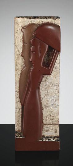 JEAN DUNAND ET JEAN LAMBERT-RUCKI BAS RELIEF, VERS 1925 A LACQUERED WOOD AND EGGSHELL BAS-RELIEF BY JEAN DUNAND AND JEAN LAMBERT-RUCKI, CIRCA 1925, SIGNED en bois laqué ocre et brun rouge, représentant un couple de profil, l'arrière plan et la partie supérieure entièrement agrémentés de coquille d'oeuf Quantité: 1 Cachet Jean Dunand Laqueur en laque rouge au revers Hauteur : 30 cm (11 3/4 in.) Largeur : 10,2 cm (4 in.) Profondeur : 4,8 cm (1 7/8 in.)