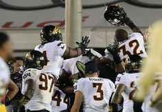 LOS ANGELES, CA - OCTOBER 04: Defensive lineman Edmond Boateng #97, defensive lineman Demetrius Cherry #94, linebacker Alani Latu #44, defensive back Damarious Randall #3 and linebacker Antonio Longino #32 of the Arizona State Sun Devils celebrate in the end zone after quarterback Mike Bercovici #5 (not in photo) threw the game-winning touchdown to Jaelen Strong #21 (not in photo) for the last play of the game to defeat USC 38-34 at Los Angeles Memorial Coliseum on October 4, 2014 in Los…