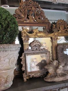 Eye For Design: Merchandise With Large, Ornate Leaning Mirrors Visual Merchandising. Retail store display.