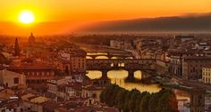 The sun sets over Florence