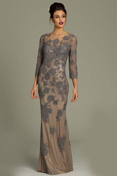 Jovani  Long sleeve lace gown featuring a sheer net lace applique overlay.
