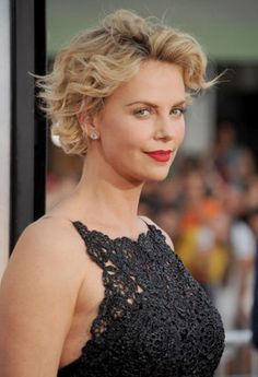 Consider Charlize's tousled crop proof that short, curly hair can absolutely work. There's nothing big or frizzy about her side-parted style.