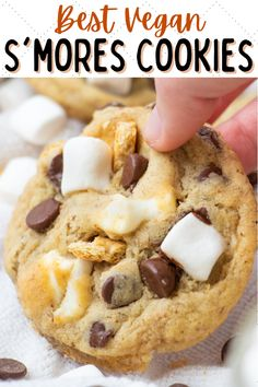 These vegan s'mores cookies are packed with chocolate, graham crackers and marshmallows! The best s'mores stuffed cookies recipe ever. #vegansmorescookies #vegansmores #vegansummerrecipes #vegansummerdesserts #vegandesserts #vegancookies