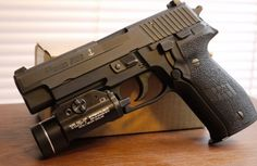 SIG P226. Gave my son my 1911. This would do fine as a replacement.