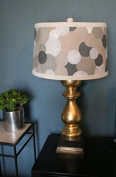 Make this lampshade for L's polka dot bedroom redo.  Yes...the, brass lamp is UGLY in this photo...but the white one already in her room or a new silver one will look FAB!