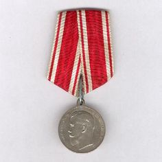 Medal for Zeal, silver, 1894-1917, with Tsar Nicholas II facing left circumscribed 'By the Grace of God Nicholas II Emperor and Autocrat of All the Russias' the reverse with a half-wreath of laurel, palm and oak and inscribed 'for Zeal', on a ribbon of the Order of St. Stanislaus. The medal was instituted in Dec 1801 and was awarded to both military & civilians for zealous service & initiative. This example dates from after the ascension of Nicholas II in 1894 and before the Revolution of…