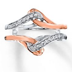 Diamonds set in 14K white gold intertwine with a swirl of 14K rose gold above and below the center in this colorful enhancer ring. The ring has a total diamond weight of 1/5 carat, and is designed to wrap around your solitaire ring (sold separately). Diamond Total Carat Weight may range from .18 - .22 carats.