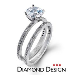Classy Collection.  This gorgeous 18K white engagement ring and band is comprised of .30ctw round white Diamonds.