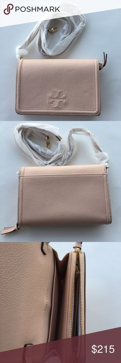 "Tory Burch Thea Flat Wallet Cross-body 🌷Please Read the description! Thanks!🌷  Brand new with tag, didn't come with a dust bag Retail: $295 Color: sweet melon Pebbled leather. Adjustable shoulder strap. Measurements: Height 5 1/2"", Length 7 3/4"",  Depth 1.5"". Strap drop: 21 3/4"" Three ways: a clutch, a wallet and a crossbody Color may be slightly different bcz of lighting  🌷Price is FIRM unless bundled 🌷NO Trades         🌷NO Holds 🌷All sales are final Welcome product-related questions…"